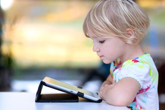 https://cdn.allaboutvision.com/images/blond-child-reading-tablet-330x220.jpg