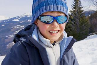 https://cdn.allaboutvision.com/images/boy-sunglasses-snow-330x220.jpg