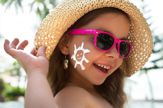 https://cdn.allaboutvision.com/images/girl-sunglasses-sunblock-hat-660x440.jpg